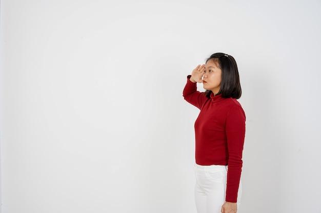 Beautiful indonesian woman saluting gesture