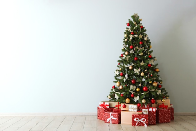 Beautiful interior decorated for christmas or new year christmas tree and gifts place for text