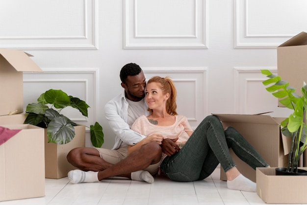 Beautiful interracial couple getting ready to move