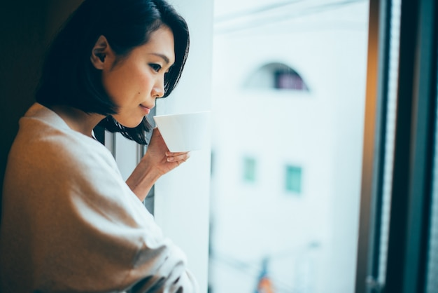 Beautiful japanese woman, lifestyle moments in a traditional apartment