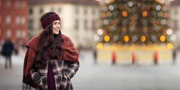 Beautiful joyful woman in a city