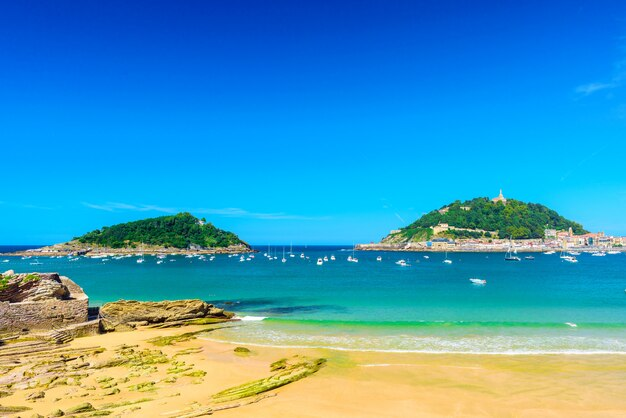 Beautiful la concha beach with nobody at san sebastian donostia, spain. best european beach in sunny day