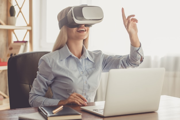 Beautiful lady in formal shirt is using virtual reality.