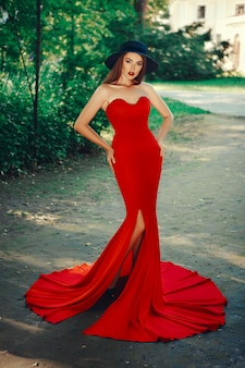 Beautiful lady is posing in a sexy red dress