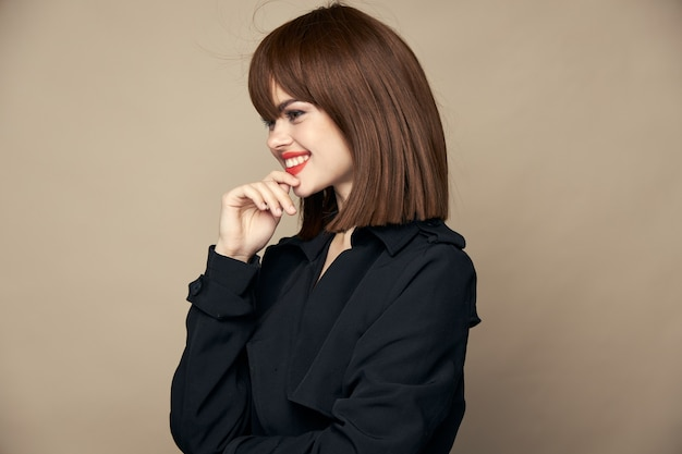 Beautiful lady in stylish clothes with elegant haircut