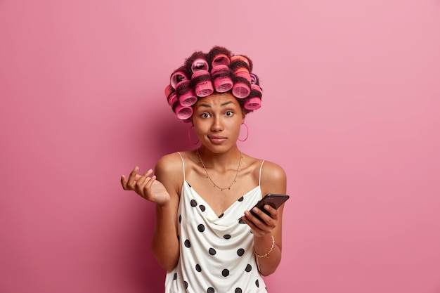 Beautiful lady wearing hair curlers isolated