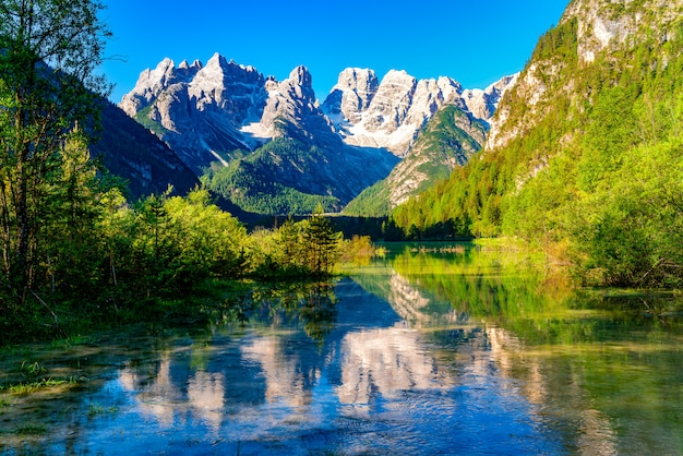 Beautiful lake durrensee or lake landro and the dolomites mountain in the morning at south tyrol, italy.