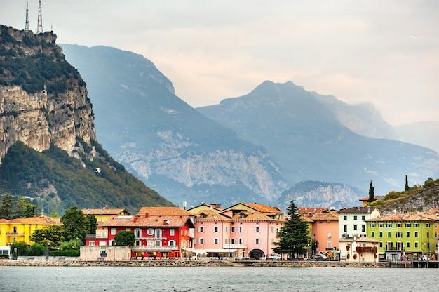 Beautiful lake lago di garda and the village of torbole alpine scenery italy