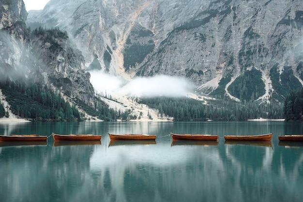 Beautiful lake with boats in the italian alps, lago di braies