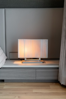 Beautiful lamp beside bed decoration in bedroom