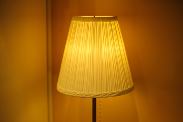 Beautiful lampshade in bedroom with place for text