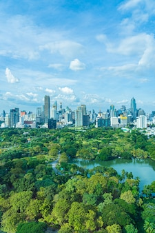 Beautiful landscape of cityscape with city building around lumpini park in bangkok thailand