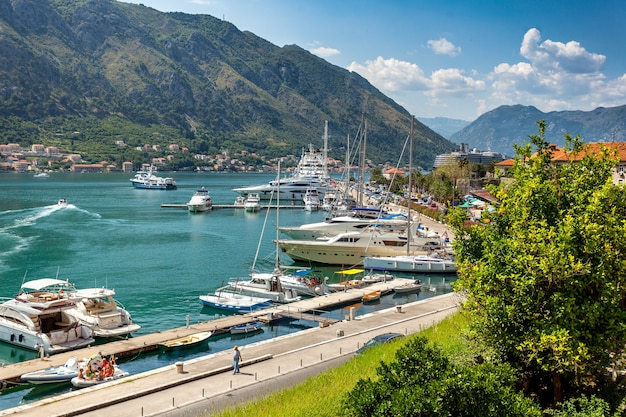Beautiful landscape of kotor bay with moored yachts at sunny day