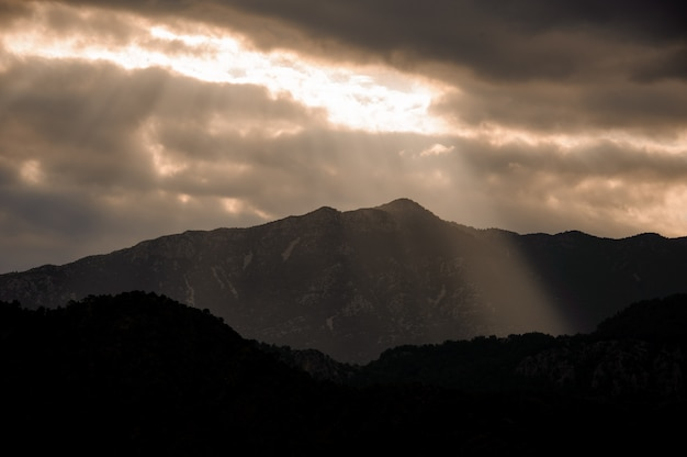 Beautiful landscape of the mountain under the cloudy sky with light