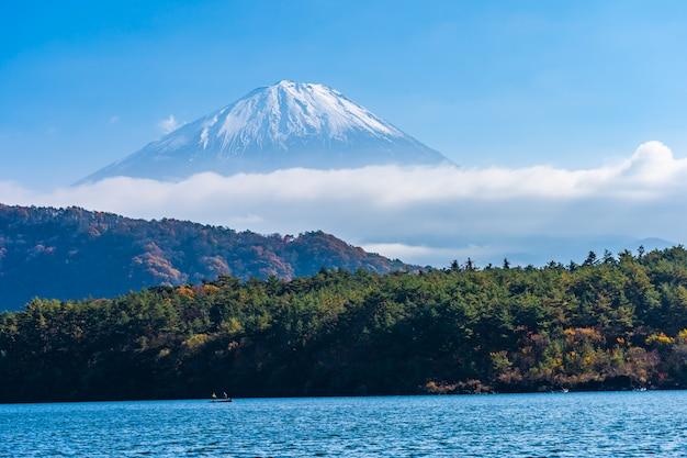 Beautiful landscape of mountain fuji with maple leaf tree around lake