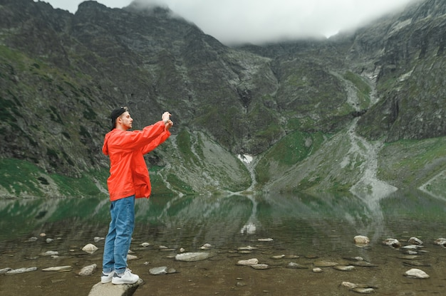 Beautiful landscape of mountain and lake with man