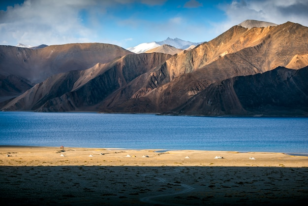Beautiful landscape mountains on pangong lake with blue sky background. leh, ladakh, india