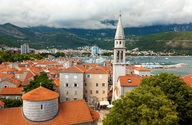 Beautiful landscape of old city with red roofs and high tower