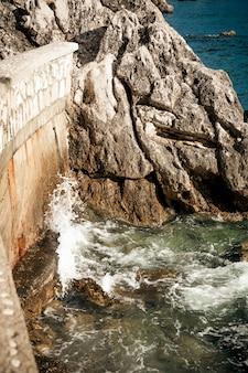 Beautiful landscape of sea waves breaking on high cliffs
