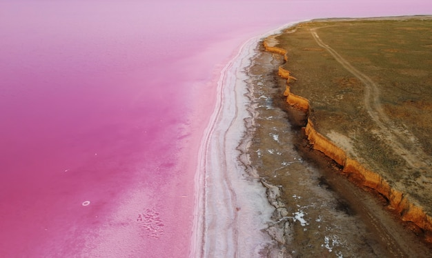 Beautiful landscape on the shores of a pink lake that has healing properties and a natural pink color.