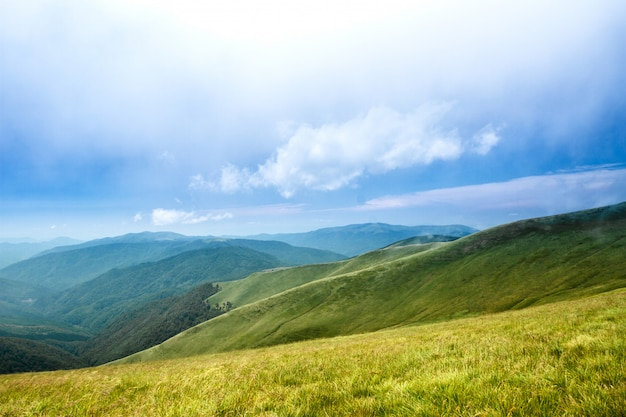 Beautiful landscape of ukrainian carpathian mountains and cloudy sky.