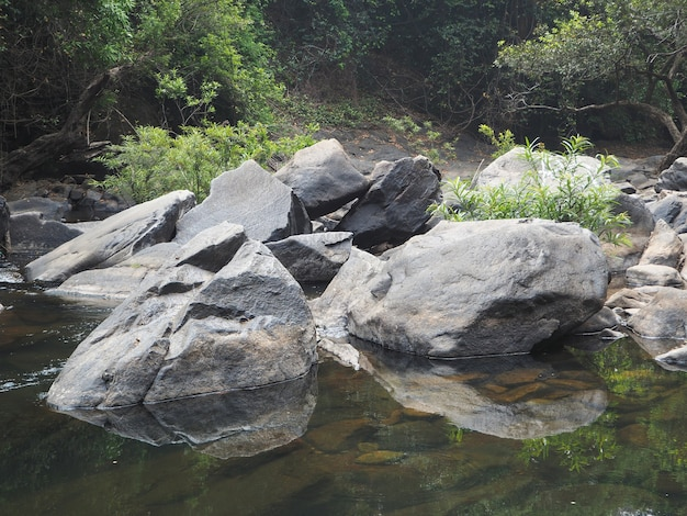 Beautiful landscape with huge boulders through which the river flows slowly