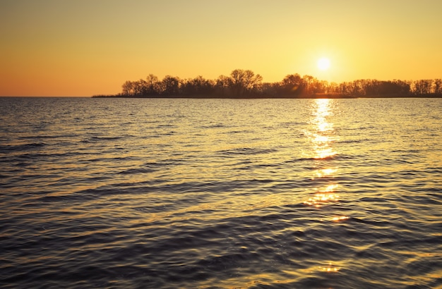 Beautiful landscape with lake and sunset sky. composition of nature