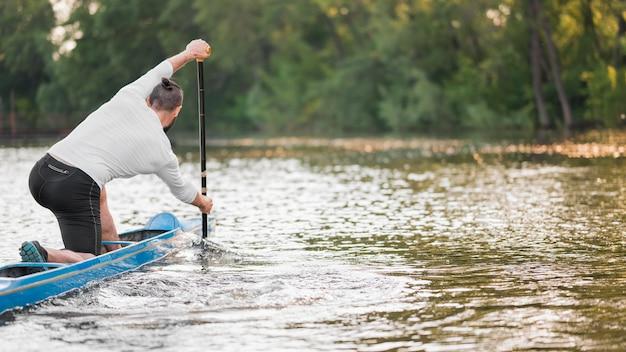 Beautiful landscape with man paddling