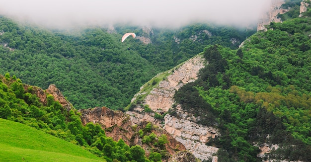 Beautiful landscape with paragliders.