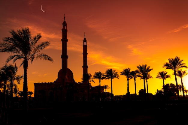 Beautiful large islamic mosque at the sunset sky background