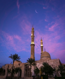 Beautiful large islamic mosque at the sunset sky
