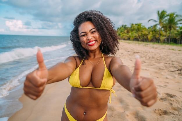 Beautiful latin american woman in bikini on the beach