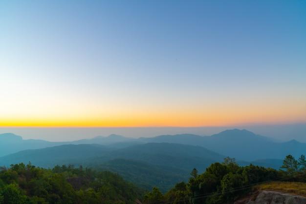 Beautiful layer mountain with twilight sunrise sky