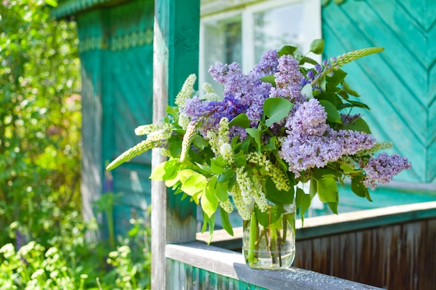 Beautiful lilac flowers in basket outdoor  summer. botanical natural background
