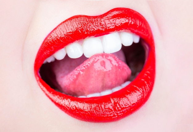 Beautiful lip, lipstick and lipgloss, passionate. tongue and sexy mouth. woman lip, female lips. sexy lips, tongue out. beautiful sexy woman, nude girl. close up, macro with beautiful mouth.