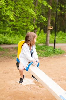 Beautiful little cute baby girl on children's playground
