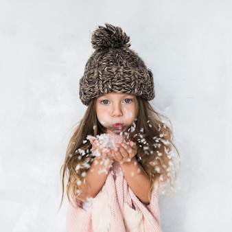 Beautiful little girl bowing flakes