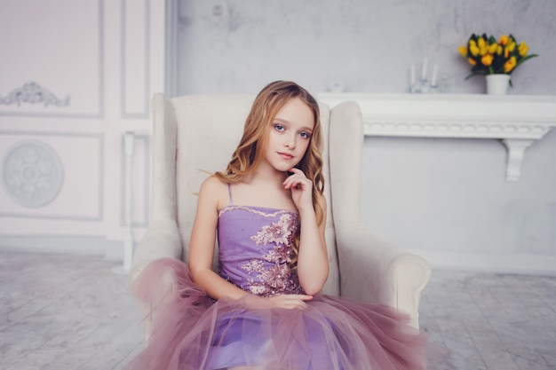 Beautiful little girl in a chic dress