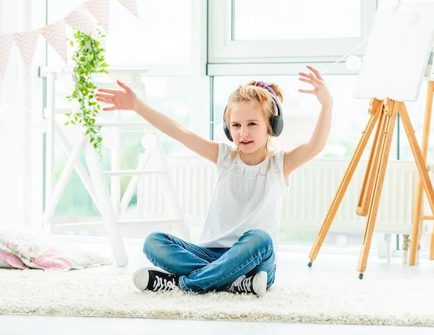 Beautiful little girl dancing to music