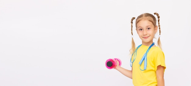 Beautiful little girl doing exercises isolated on white banner copy space