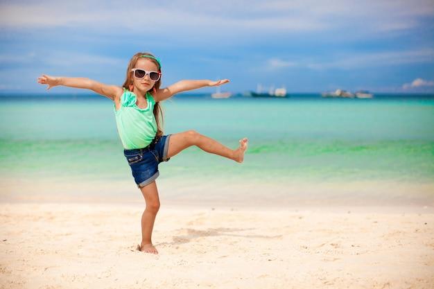 Beautiful little girl having fun on an exotic beach