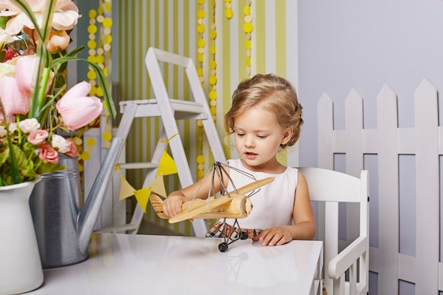 Beautiful little girl playing toys.
