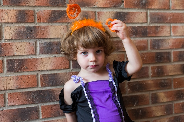Beautiful little girl smiling and wearing halloween costume