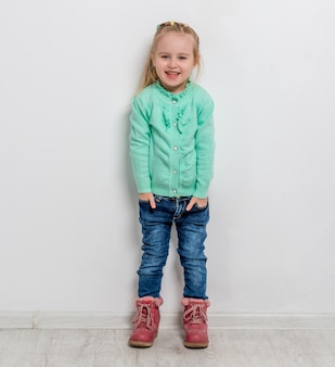 Beautiful little girl with her hands in pockets