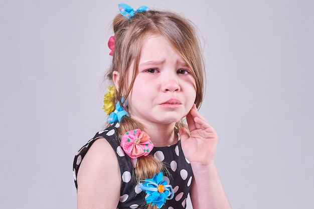A beautiful little girl with a sad expression of her face is going to cry