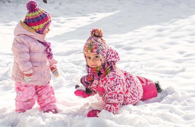 Beautiful little girls playing in the snow