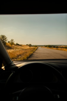 Beautiful lonely road view from driver seat