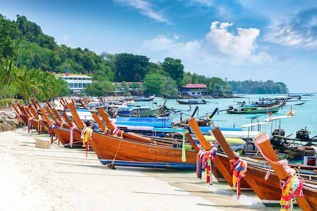 Beautiful long beach with boats, phi phi island, thailand. tropical landscape. travel concept.