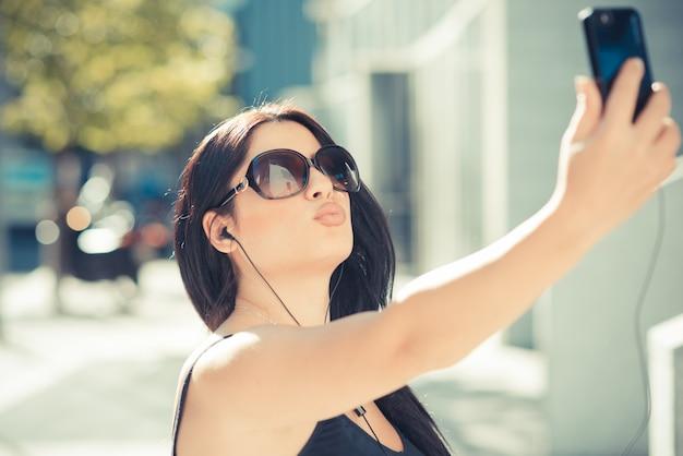 Beautiful long black hair elegant business woman using smartphone