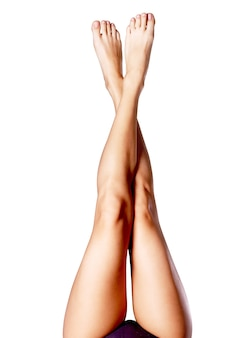 Beautiful long slender female legs after depilation.